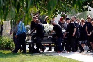 10-2 -photo-at-funeral